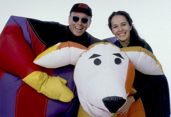 Fred Garbo in an inflatable suit, Naielma Santos and an inflatable dog