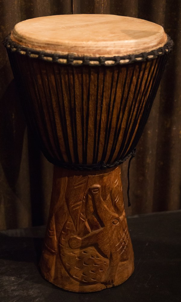 Djembe drum with a crocodile carving