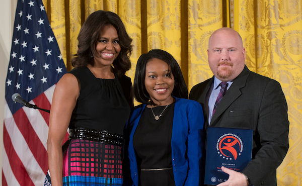 Sendie Brunard and New Victory Youth Corps Manager Anthony Pound accept the NAHYP Award from First Lady Michelle Obama