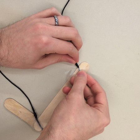 Taping marionette strings to each end of the control