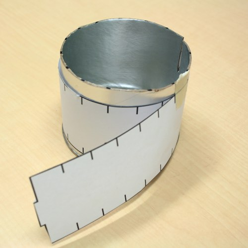 Step 3 (cont.): Wrap template filmstrip around canister as a marking guide