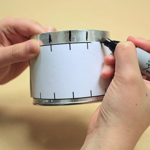 Step 4: Mark the canister according to the template's marks