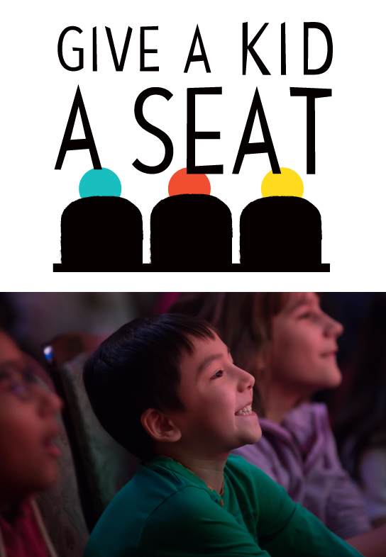 Give a Kid a Seat: Image of schoolkids enjoying a performance