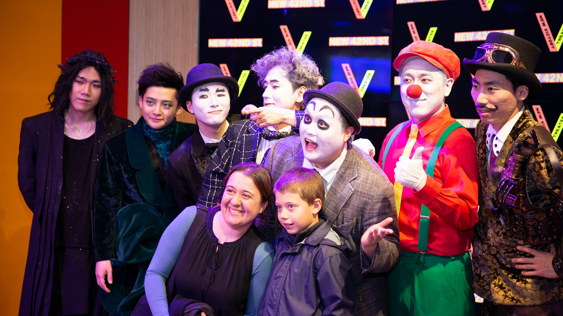 A mom and her son pose for a photo with the cast of SNAP at a post-show Meet & Greet.