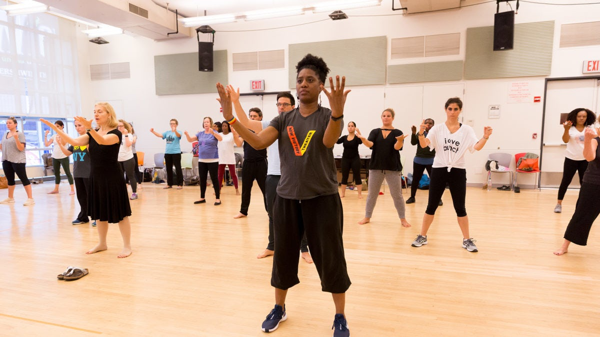 A New Victory Teaching Artist leads a group of teachers in a dance-focused Professional Development workshop.