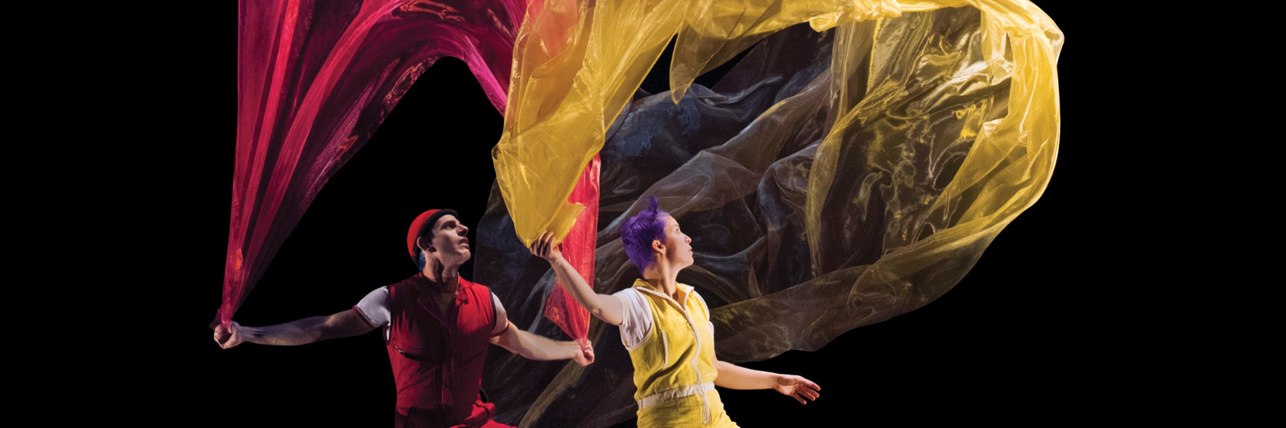Acrobuffos with billowing fabric in a scene from Air Play