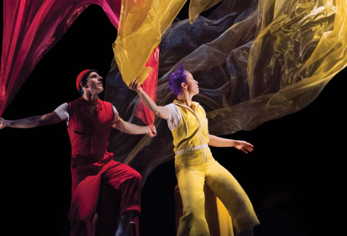 Acrobuffos with billowing fabric in a scene from Air Play.