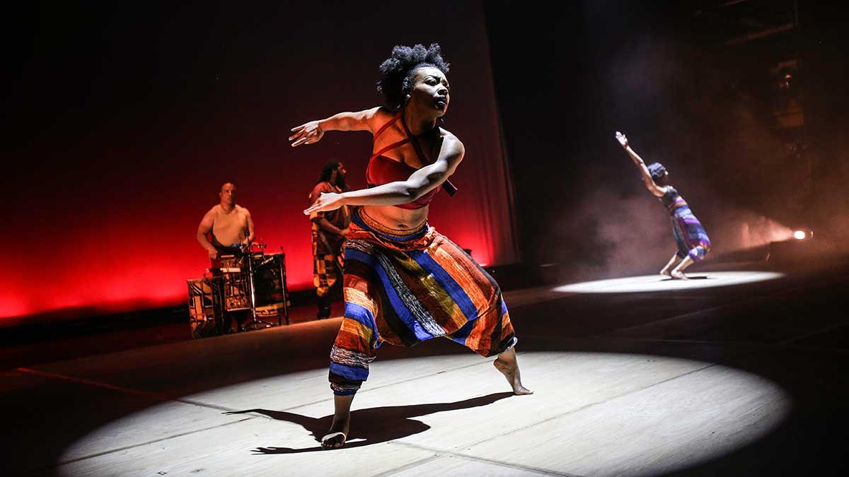 A dancer in a scene from Step Afrika!'s Drumfolk
