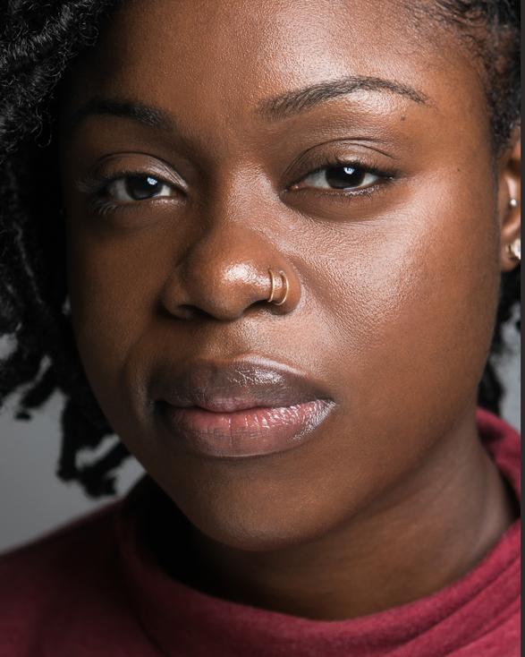 Headshot of Indygo Afi Ngozi