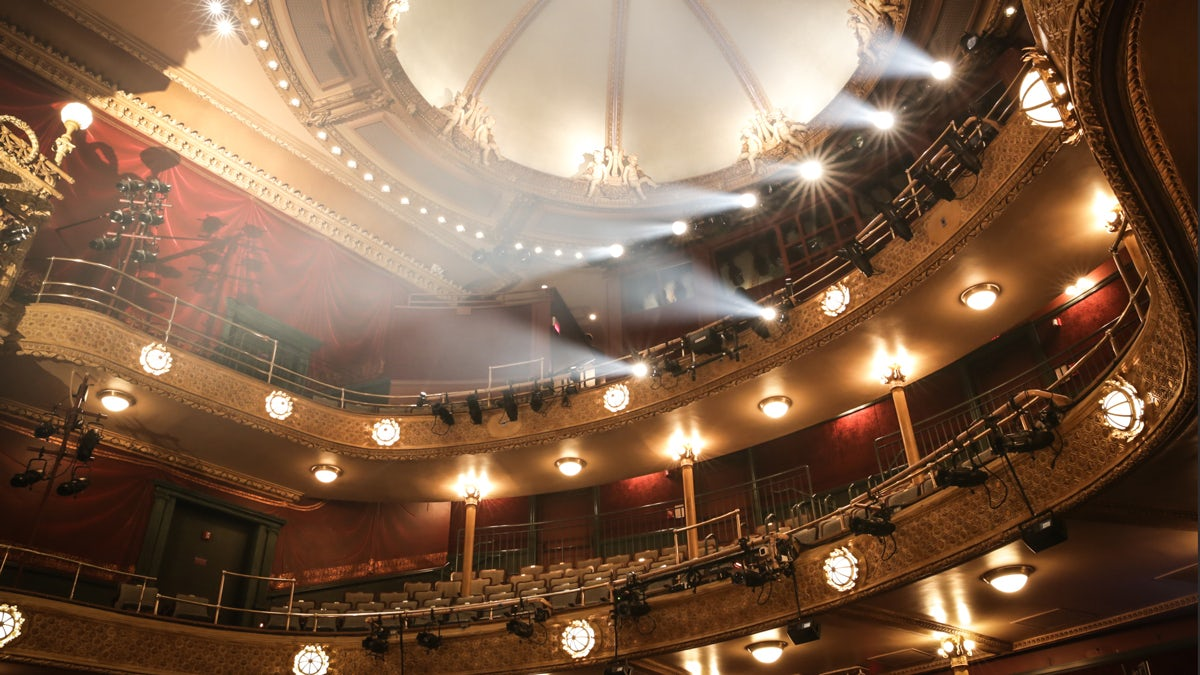 Interior of the New Victory Theater with stage lights in balcony